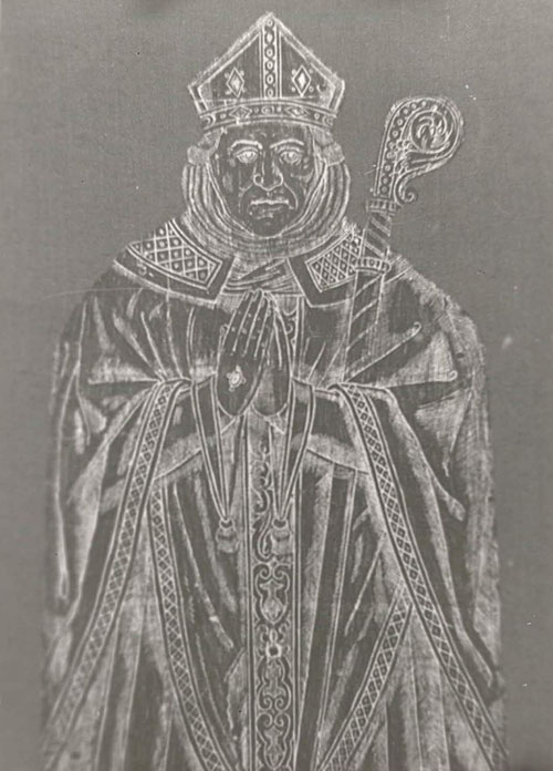 Brass rubbing of a sixteenth-century tomb of a man in bishop's robes and mitre.